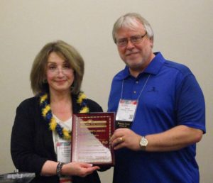 President's Award to George Rhoades for Invaluable Service to the Division from president Elizabeth Carll